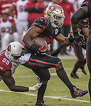 San Francisco 49ers running back Carlos Hyde (28) get away from Arizona Cardinals outside linebacker Chandler Jones (55) on Thursday, October 06, 2016 at Levis Stadium in Santa Clara, California. The Cardinals defeated the 49ers 33-21.