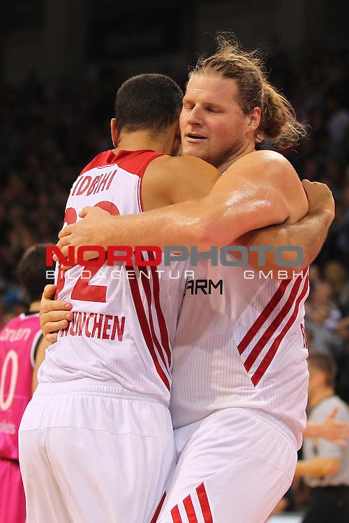 03.10.2013, Telekom Baskets Dome, Bonn, GER, BBL, Telekom Baskets Bonn vs FC Bayern M&uuml;nchen, im Bild<br /> Torjubel / Jubel  Yassin Idbihi (Muenchen #32) und John Bryant (Muenchen #54) <br /> <br /> Foto &copy; nph / Mueller