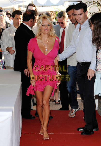 """PAMELA ANDERSON .arriving at boat party taking place on the Budweiser Select Yacht for her new film """"Blonde and Blonder"""" during the 60th International Cannes Film Festival, Cannes, .France, May 18th 2007..full length pink dress barefoot bare feet.CAP/PL.©Phil Loftus/Capital Pictures"""