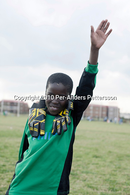 SOWETO, SOUTH AFRICA - MAY 15: A goalkeeper warms up before a street soccer game on May 15, 2010, in the Jabulani section in Soweto, Johannesburg, South Africa. Thousands of young boys play soccer in townships such as Soweto, dreaming about being the next big star. The upcoming World Cup soccer tournament in the country has greatly increased the soccer interest in the country. (Photo by Per-Anders Pettersson)