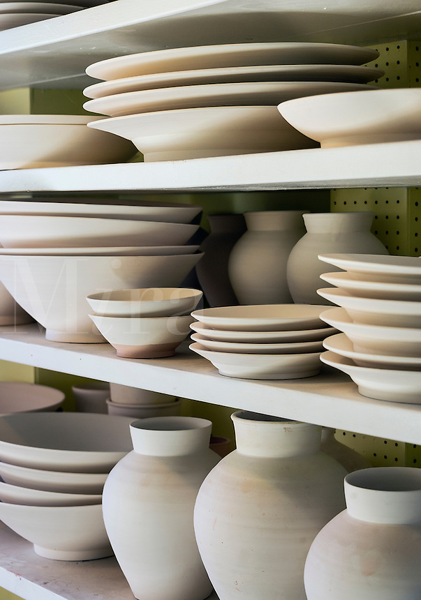 Unglazed earthenware in a pottery studio, Vermont, USA