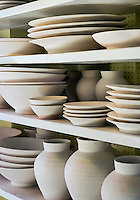 Unglazed earthenware in a pottery studio, Vermont, USA
