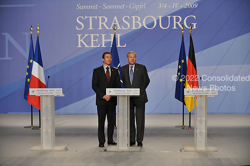 Strasbourg, France - April 4, 2009 -- At the Summit in Strasbourg and Kehl, the 28 NATO Heads of State and Government agreed uninamously to appoint Prime Minister Anders Fogh Rasmussen of Denmark, left, as NATO's next Secretary General.  Mr Fogh Rasmussen will formally take up his duties on August 1, 2009, when the term of the current Secretary General, Jaap de Hoop Scheffer, right, expires after five and a half years at the helm of the Alliance.  NATO Secretary General Jaap de Hoop Scheffer announces his successor, Anders Fogh Rasmussen, Prime Minister of Denmark at the final press conference at Strasbourg..Mandatory Credit: NATO via CNP