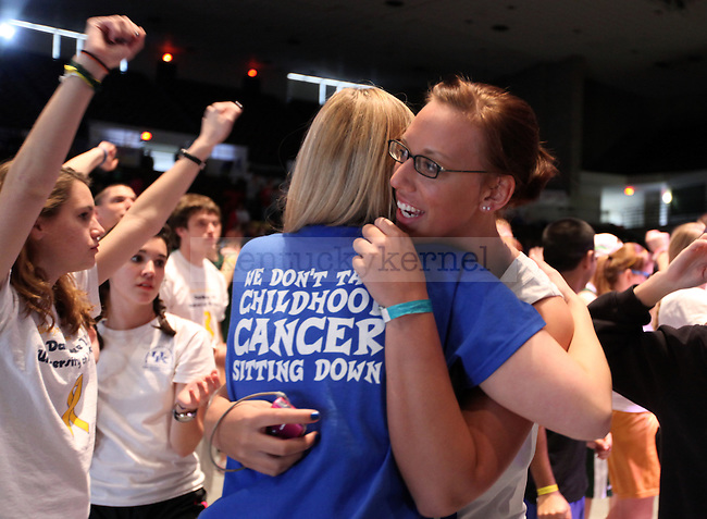 Communication Sophomore Liz Pawley hugs fellow Alpha Theta sister LeighAnn Renfro at the Dance Blue dance marathon for children with cancer on Saturday, Feb. 19, 2011.  Photo by Britney McIntosh | Staff