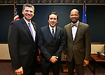 Nevada Assemblyman James Healey, D-Las Vegas, actor Nicolas Cage and Nevada Sen. Aaron Ford, D-Las Vegas, pose at the Legislative Building Carson City, Nev., on Tuesday, May 7, 2013. Cage testified in support of Ford's measure proposing tax incentives to filmmakers..Photo by Cathleen Allison