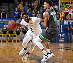 BROOKINGS, SD - DECEMBER 12: Tevin King #2 from South Dakota State tidies to get a step against Geno Crandall #0 from North Dakota during their game Tuesday night at Frost Arena in Brookings, SD. (Photo by Dave Eggen/Inertia)