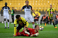 Melbourne Victory&rsquo;s Lawrence Thomas and Wellington Phoenix&rsquo; Andrija Kaluderovic in action during the A League - Wellington Phoenix v Melbourne Victory FC at Westpac Stadium, Wellington, New Zealand on Wednesday 10 January 2018. <br /> Photo by Masanori Udagawa. <br /> www.photowellington.photoshelter.com