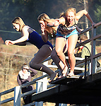 Nancy Martin, Savannah Easterday , and Heidi Edgecone (left to right) jumps off the bridge into the Burley Lagoon during the 31st annual Polar Bear on January 1, 2015 in Olalla, Washington. Over 500 hardy participants joined in on the annual New Year's Day Tradition by jumping into the chilly lagoon waters during the annual Polar Bear Plunge.  ©2015.  Jim Bryant Photo. All Rights Reserved.