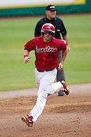 Stony Brook Seawolves first baseman Kevin Courtney #25 rounds the bases after hitting a home run during the NCAA Super Regional baseball game against LSU on June 9, 2012 at Alex Box Stadium in Baton Rouge, Louisiana. Stony Brook defeated LSU 3-1. (Andrew Woolley/Four Seam Images)