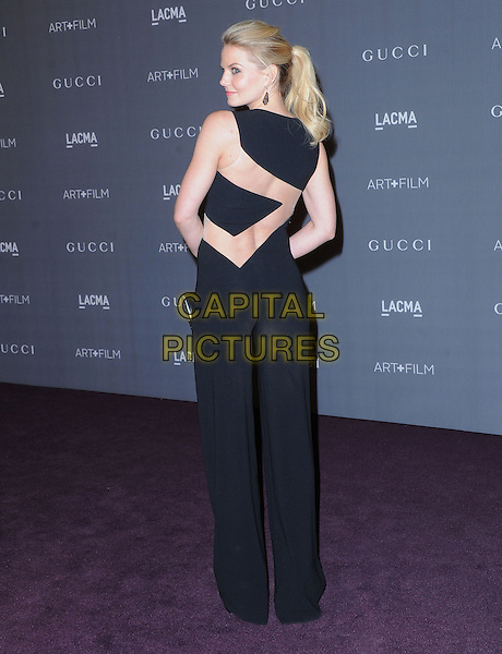 Jennifer Morrison.at The LACMA 2012 Art and Film Gala held at LACMA in Los Angeles, California, USA, October 27th 2012..full length black cut out pantsuit catsuit jumpsuit back rear behind over shoulder .CAP/RKE/DVS.©DVS/RockinExposures/Capital Pictures.