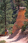 Hikers next to Hoodoos within Bryce Canyon, Bryce Canyon National Park, UTAH