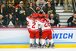 ADRIAN, MI - MARCH 18: Plattsburgh State University celebrates a goal during the Division III Women's Ice Hockey Championship held at Arrington Ice Arena on March 19, 2017 in Adrian, Michigan. Plattsburgh State defeated Adrian 4-3 in overtime to repeat as national champions for the fourth consecutive year. by Tony Ding/NCAA Photos via Getty Images)