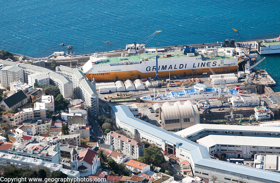 View over docks and shipyard warehouses in Gibraltar, British territory in southern Europe