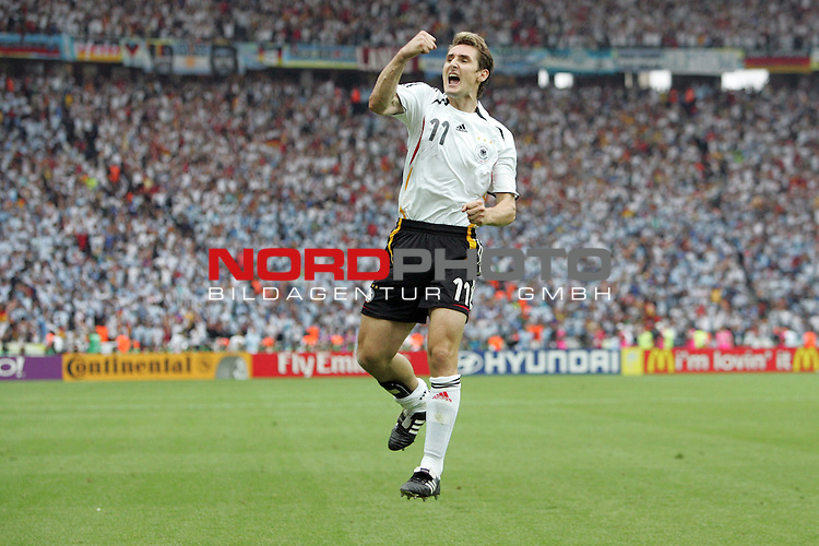 FIFA WM 2006 - Quarter-finals / Viertelfinale<br /> <br /> Play #57 (30-Jun) - Germany vs Argentina.<br /> <br /> Miroslav Klose from Germany celebrates his 1-1 goal during the match of the World Cup in Berlin.<br /> <br /> Foto &copy; nordphoto
