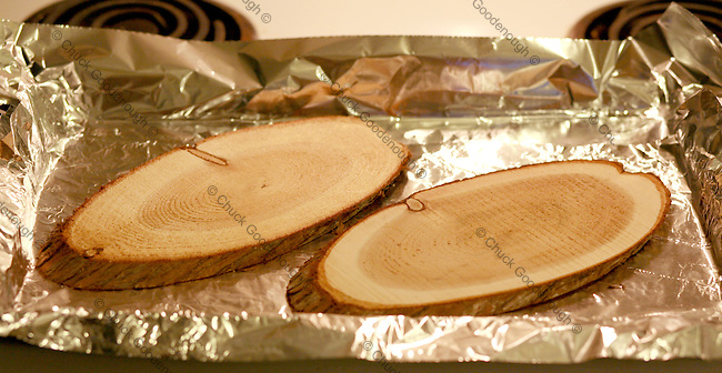 Put the planks on a foil lined cookie sheet - do not soak the planks in water if using in the oven.
