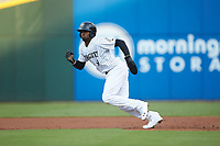 Luis Robert (9) of the Charlotte Knights takes off for second base during the game against the Scranton/Wilkes-Barre RailRiders at BB&T BallPark on August 13, 2019 in Charlotte, North Carolina. The Knights defeated the RailRiders 15-1. (Brian Westerholt/Four Seam Images)