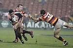 Male Sa'u gets taken by Steven Bates after avoiding the tackle of Stephen Donald during the Air NZ Cup week 5 game between Waikato & Counties Manukau played at Rugby Park, Hamilton on 26th of August 2006.
