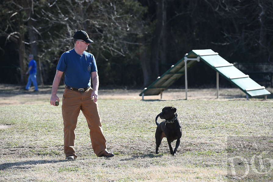 """NWA Democrat-Gazette/J.T. WAMPLER Tim Wardlow of Springdale plays fetch with his dog Zeus Monday Jan. 7, 2019 at the dog park at C.L. """"Charlie"""" & Willie George Park in Springdale. The dog park is part of a a 75-acre park located at the southeast intersection of Don Tyson Parkway and Hylton Road."""