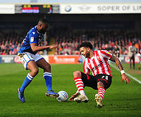 Lincoln City's Bruno Andrade vies for possession with Macclesfield Town's Nathan Cameron<br /> <br /> Photographer Andrew Vaughan/CameraSport<br /> <br /> The EFL Sky Bet League Two - Lincoln City v Macclesfield Town - Saturday 30th March 2019 - Sincil Bank - Lincoln<br /> <br /> World Copyright © 2019 CameraSport. All rights reserved. 43 Linden Ave. Countesthorpe. Leicester. England. LE8 5PG - Tel: +44 (0) 116 277 4147 - admin@camerasport.com - www.camerasport.com