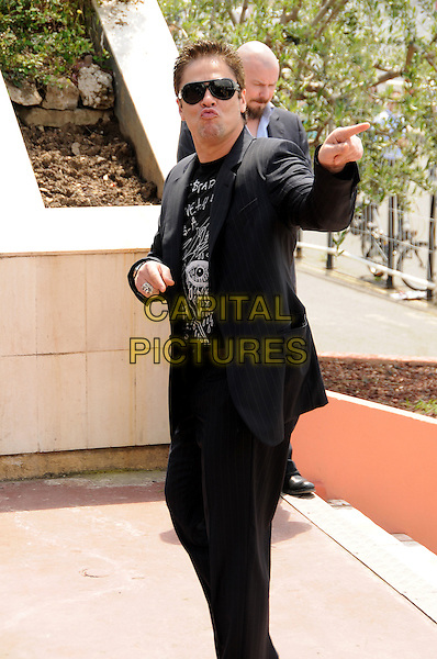 BENICIO DEL TORO .attends the Jury Photocall at the Palais des Festivals during the 63rd Annual Cannes International Film Festival, Cannes, France, 12th May 2010..half 3/4 length black suit sunglasses finger pointing gesture  mouth pouting funny .CAP/CAS.©Bob Cass/Capital Pictures.