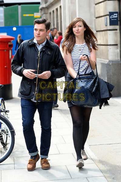 MATHEW HORNE & GUEST.Arriving at the BBC, London, England..May 14th, 2010.mat matthew matt full length jeans denim black jacket tights white striped stripes top blue bag purse .CAP/DYL.©Dylan/Capital Pictures.