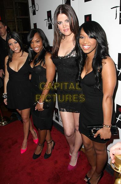 KHLOE KARDASHIAN, KOURTNEY KARDASHIAN & friends .Khloe Kardashian hosts the Anti-Valentine's Day Party on Friday the 13th at TAO Nightclub inside the Venetian Resort Hotel and Casino, Las Vegas, Nevada, USA, 13th February 2009..full length black mini lace dress pink pointy shoes sisters .CAP/ADM/MJT.©MJT/Admedia/Capital Pictures