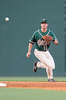 Shortstop Justin Bohn (14) of the Greensboro Grasshoppers tracks a grounder in a game against the Greenville Drive on Wednesday, May 7, 2014, at Fluor Field at the West End in Greenville, South Carolina. Greenville won, 12-8. (Tom Priddy/Four Seam Images)