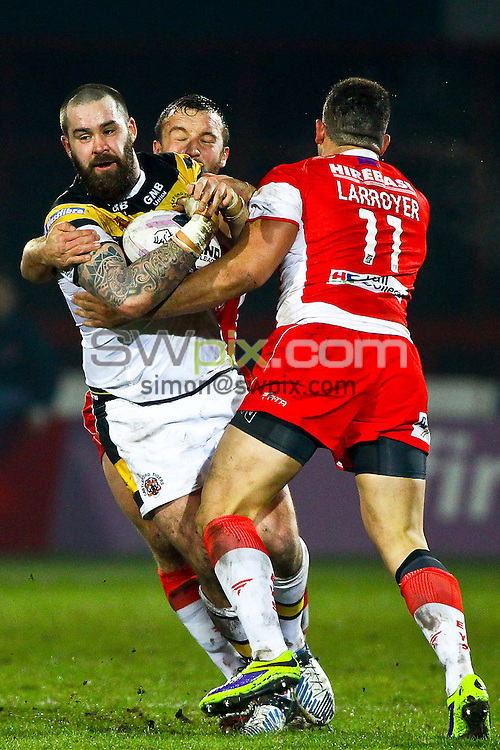 Picture by Alex Whitehead/SWpix.com - 28/02/2014 - Rugby League - First Utility Super League - Hull Kingston Rovers v Castleford Tigers - KC Lightstream Stadium, Hull, England - Castleford's Craig Huby is tackled by Hull KR's Josh Hodgson and Kevin Larroyer.
