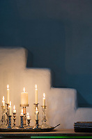 The whitewashed stairs are given a whole other dimension in the evenings, when Anurag lights the old candleholders from Italy