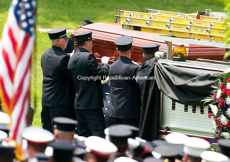 WATERBURY, CT- 25 MAY 07- 052507JT09- <br /> Pallbearers removed the casket of Waterbury Fire Department Capt. John Keane from Engine 7 at  Calvary Cemetery in Waterbury on Friday. Keane was killed due to injuries suffered when two fire trucks collided at East Aurora Street and Route 73 in Waterbury on Saturday, May 19.<br /> Josalee Thrift Republican-American