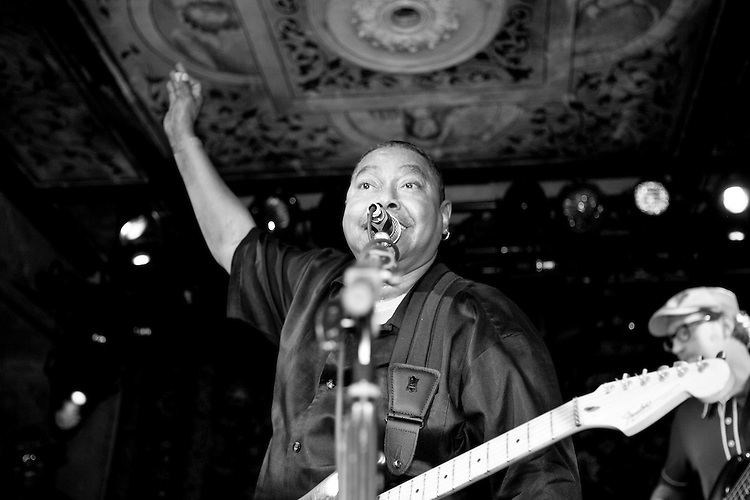 """Charles """"Skip"""" Pitts of the Bo-Keys plays his guitar at the 8th annual Ponderosa Stomp, held at the House of Blues in New Orleans on April 28, 2009. <br /> <br /> The Bo-Keys are a new old band, formed in 1998 by Memphis musician Scott Bomar who was asked to assemble a backup band for former Stax Records artist Sir Mack Rice.  Bomar then went to the source and enlisted former Stax session musicians Skip Pitts, Howard Grimes, and Ben Cauley.  Skip Pitts is perhaps best known for creating the distinctive """"wah wah"""" guitar sound for the title track of Isaac Hayes' record """"Shaft"""".       <br /> <br /> The Ponderosa Stomp is an annual music festival held in New Orleans since 2002 that celebrates the uncelebrated names in American musical history.  The festival spotlights musicians who have contributed to the American roots musical canon in various genres, from rockabilly to soul to rock and roll to jazz to experimental.  For two nights of the year these mostly forgotten names perform to an audience of aficionados whose memory has not faded and turn back the clock with blistering performances of the hits that did or (in the case of the regional musicians that plugged away unknown to the world at large, as well as those whose songs were recorded to acclaim by other musicians) did not make them famous.  <br /> <br /> In addition to the two nights of performances the Ponderosa Stomp Foundation (the non-profit founded by the eccentric Dr. Ira Padnos and his coterie of like minded music fanatics the Mystic Knights of the Mau Mau) also produces two days of the Music History Conference, where many of the performers, as well as other music industry names, share stories of their lives in the business.  The Conferences take place in the Louisiana State Museum at the Cabildo in Jackson Square."""