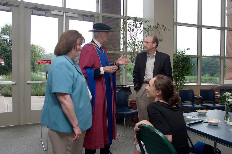 17016Undergraduate Commencement Photo: Charles Stuckey / Dr. McDavis receiving degree / College of Edu. Reception: Photos by Edmund Lo