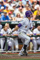 LSU Tigers outfielder Mark Laird (9) follows through on his swing against the TCU Horned Frogs in the NCAA College World Series on June 14, 2015 at TD Ameritrade Park in Omaha, Nebraska. TCU defeated LSU 10-3. (Andrew Woolley/Four Seam Images)