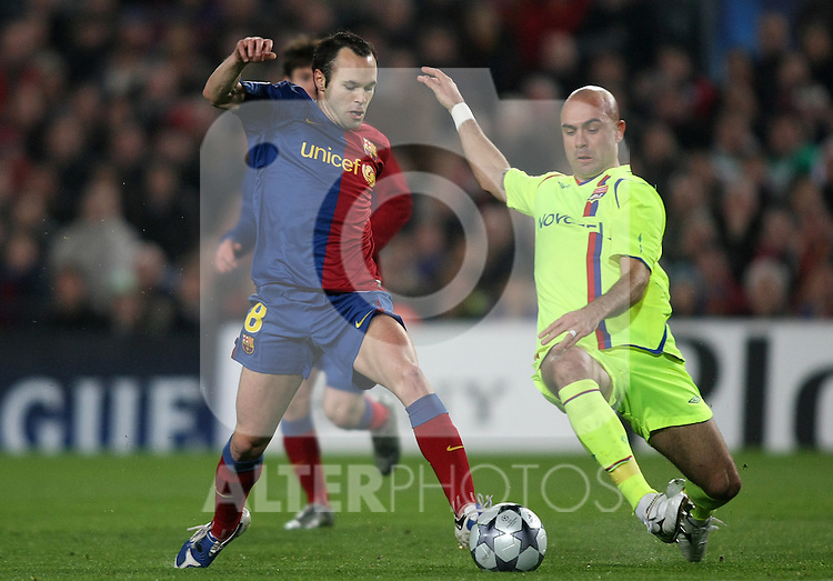 FC Barcelona's Andres Iniesta (l) and Olympique Lyon's Cris (r) during the UEFA Champiosn League match.March 11 2009. (ALTERPHOTOS/Acero).