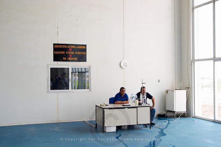Two men guarding the distillation room. Tsantali Vineyards & Winery, Halkidiki, Macedonia, Greece.