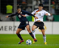 Carli Lloyd (left) battles against Linda Bresonik (right). US Women's National Team defeated Germany 1-0 at Impuls Arena in Augsburg, Germany on October 29, 2009.