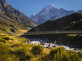 NEW ZEALAND, Aoraki Mount Cook National Park, Trail Running across the Hooker River Bridge on the Hooker Valley Track, Ben M Thomas