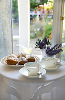 Lavender cup cakes with lavender and honey infused tea on a table by the window