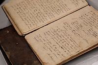 Ledgers from St. Johns Lodge of New Bern in the early 1800's.    Chuck Beckley/ The Sun Journal
