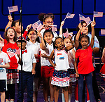 WATERBURY,  CT-052019JS05- Students from Generali Elementary School wave their American flags as they sing a patriotic medley during the Waterbury Public School's Celebration Community Through the Arts II district-wide talent show held Monday at the Palace Theater in Waterbury. <br /> Jim Shannon Republican American