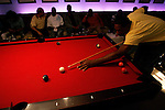 Corey Stokes plays pool at Jay Z's 40/40 Club while other players watch MTV's Video Music Awards on TV on August 31, 2006.  The high school players were in town for the Elite 24 Hoops Classic, which brought together the top 24 high school basketball players in the country regardless of class or sneaker affiliation.
