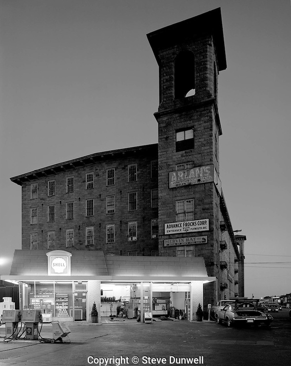 Richard Borden Mill, Fall River, MA with gas station.  built ca 1873, burned ca 1990.