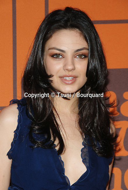 Mila Kunis arriving at the That' 70' Show Final Party at the Tropicana at the Roosevelt Hotel Hotel in Los Angeles.. May 6,  2006.