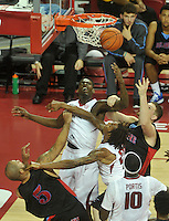 NWA Media/Michael Woods --11/21/2014-- w @NWAMICHAELW...University of Arkansas forward Jacorey Williams (l;eft) and Michael Qualls fight for a rebound during the first half of Friday nights game  against Delaware State at Bud Walton Arena in Fayetteville.