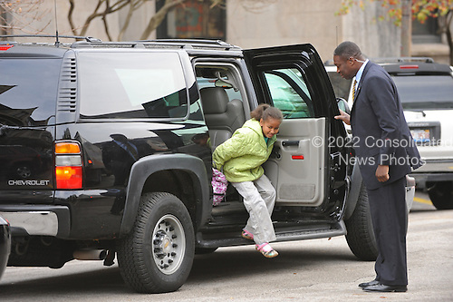 Chicago, IL - November 13, 2008 -- Sasha Obama, daughter of United States President-elect Barack Obama, gets dropped off for school with her sister as her dad waits in the car in Chicago, Illinois on Thursday, November 13, 2008.  Obama is working mostly in the Chicago area as he prepares for his transition to become the 44th United States President. .Credit: Amanda Rivkin - Pool via CNP