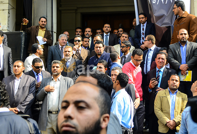 Egyptian lawyers shout slogans against the Interior Ministry during a protest in front of the Lawyers' Syndicate headquarters in Cairo, March 05, 2015, after the death of lawyer Karim Hamdy in the Police Department last week. Two Egyptian policemen accused of killing a lawyer in custody were detained on Thursday on the orders of an Egyptian prosecutor, judicial sources said, a rare action against members of the security forces. Photo by Amr Sayed