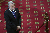 Quebec Premier Philippe Couillard pays respect to former Quebec premier Jacques Parizeau who lies in state at the National Assembly in Quebec City on Sunday June 7, 2015.
