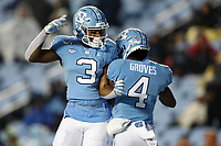 CHAPEL HILL, NC - NOVEMBER 23: Rontavius Toe Groves #4 and Antoine Green #3 of the University of North Carolina celebrate in the end zone during a game between Mercer University and University of North Carolina at Kenan Memorial Stadium on November 23, 2019 in Chapel Hill, North Carolina.