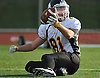Pat O'Brien #81 of Northport looks for a referee's signal after making an acrobatic catch in the end zone for a touchdown in the third quarter of a Suffolk County Division I varsity football game against host Whitman High School on Saturday, Oct. 29, 2016. Northport won by a score of 26-14 to clinch a playoff spot.