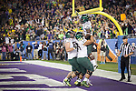 #24 Kenjon Barner is lifted into the air after he scores the ducks 3rd touchdown in the second half. ..Tribune Photo: Meg Williams ..1-3-12, DUCKS, Glendale, Jan. 3, Kansas State, Phoenix, U OF O, University of Phoenix stadium, ducks winning, fiesta bowl, first half, football, tailgating, thursday, touchdown, university of oregon